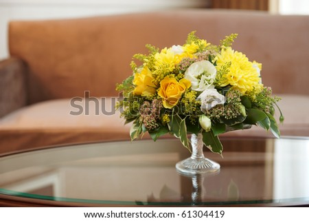 Flowers in a hotel room on coffee table