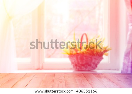 Flowers in basket. Flowers on the window. Flowers on wooden background - stock photo