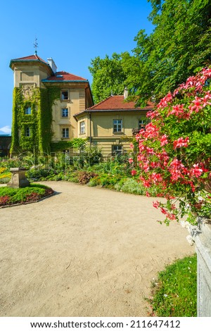 Flowers in gardens of beautiful Lancut castle on sunny summer day, Poland