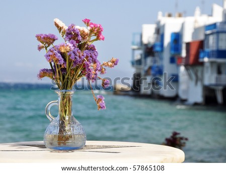 Flowers in small tavern in Small Venice in Mykonos island - stock photo