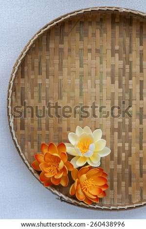 Flowers on bamboo tray