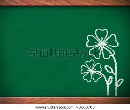 Flowers on the blackboard. - stock photo