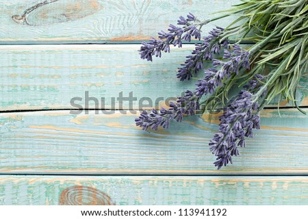 Flowers on vintage wood background - stock photo