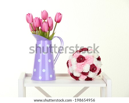 Flowers on white shelf on grey wall background - stock photo