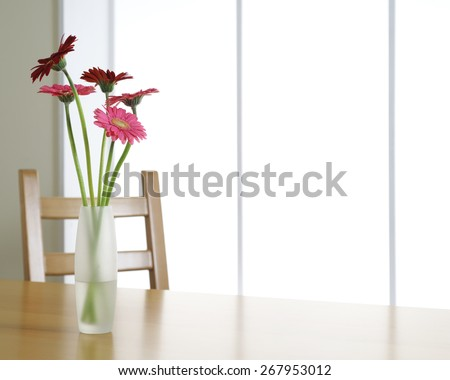 flowers on wooden table - stock photo