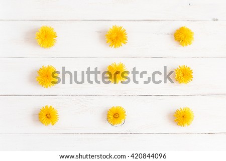 Flowers pattern, dandelions. Creative flowers. Top view, flat lay - stock photo