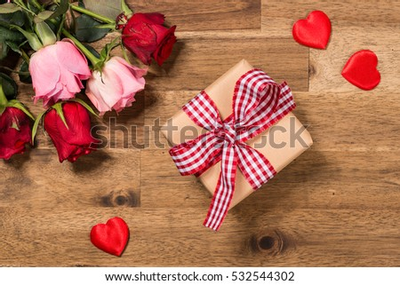 Flowers. red hearts and gift. Valentines day background