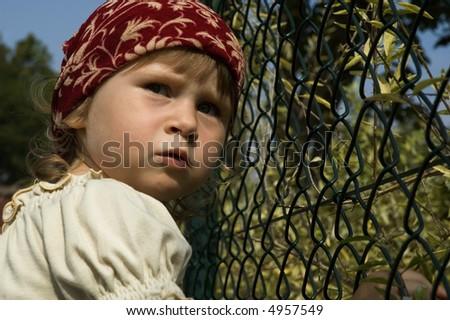 flowers robber. scared kid. sweet little girl - stock photo