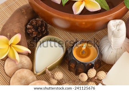 Flowers spa tub, Frangipani flowers spa tub and spa skin with Yacon roots, fresh milk and soap from natural raw materials. - stock photo