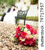 Flowers with bride and groom - stock