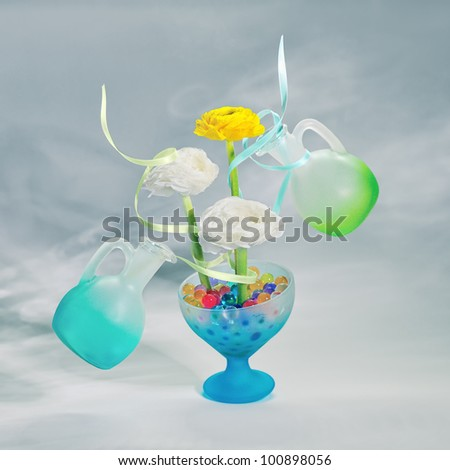 Flowers with gel balls and two bottle. - stock photo