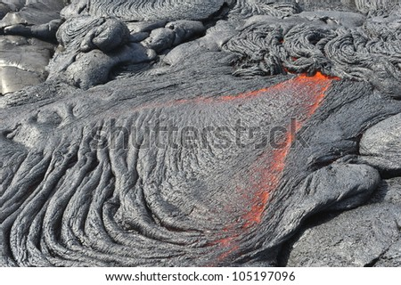 Flowing lava from Kilauea volcano, Hawaii. April, 2012. - stock photo