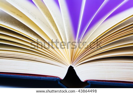 flowing pages of a book shallow dof - stock photo