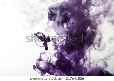 flowing purple ink in water, colored smoke - stock photo