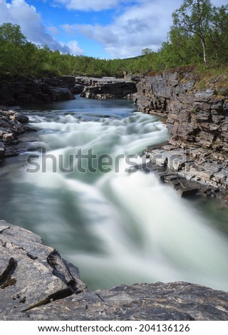 Flowing river in the canyon in Abisko National Park, Sweden - stock photo