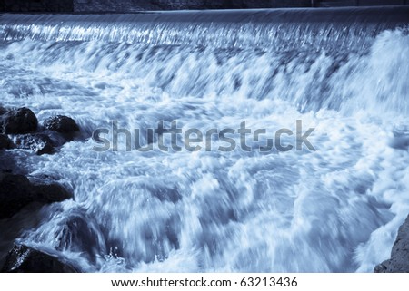 flowing water in a water gate - stock photo