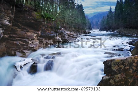 Flowing water of Carpathian mountain stream - stock photo