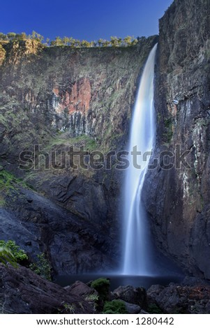 flowing waterfall in tropical australia - stock photo