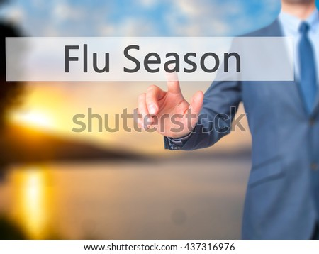 Flu Season - Businessman hand pressing button on touch screen interface. Business, technology, internet concept. Stock Photo - stock photo
