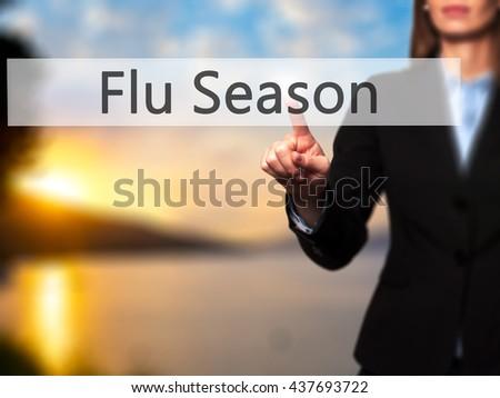 Flu Season - Businesswoman hand pressing button on touch screen interface. Business, technology, internet concept. Stock Photo - stock photo