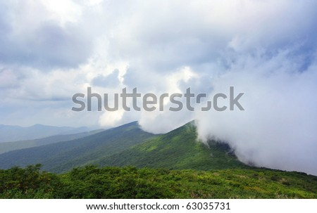 fluffy clouds rolling over the Great Smoky Mountains - stock photo