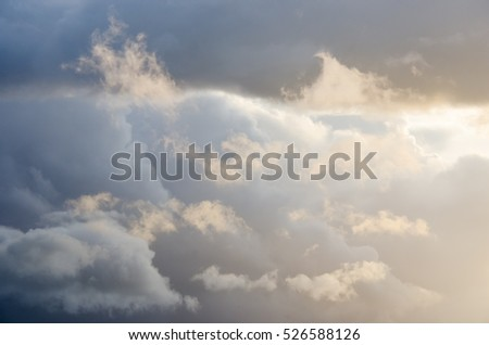 Fluffy clouds with bright sunlight and dark parts