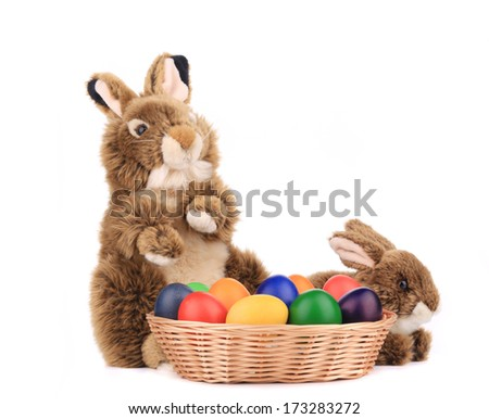 Fluffy foxy rabbit in basket with Easter eggs. Isolated on a white background. - stock photo