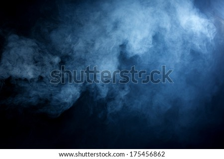 Fluffy Puffs of Smoke and Fog on Black Background - stock photo