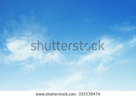 fluffy white clouds and blue sky  - stock photo