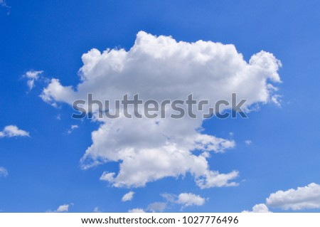 fluffy white clouds on a clear blue sky
