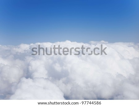 Fluffy white cumulus clouds against the sky - stock photo