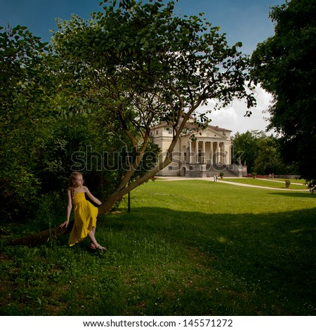 Fluing girl near renesance villa - stock photo