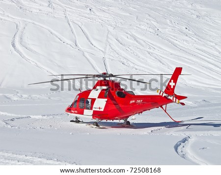 FLUMSERBERG - MARCH 5: The rescue helicopter ready to evacuate skiier after heavy accident, Flumserberg, Switzerland on March 5, 2011. Skiing safety becoming an issue on crowded slopes. - stock photo