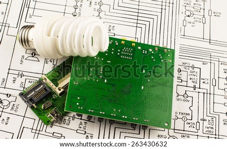 Fluorescent lamp and chip on the background drawings of microcircuits - stock photo