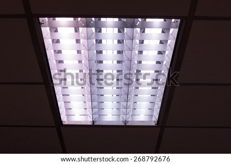 fluorescent lamp on the modern ceiling. - stock photo