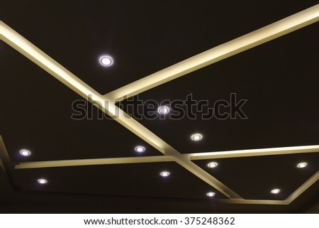 fluorescent lamp on the modern ceiling - stock photo