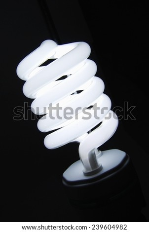 Fluorescent light bulb isolated on black background