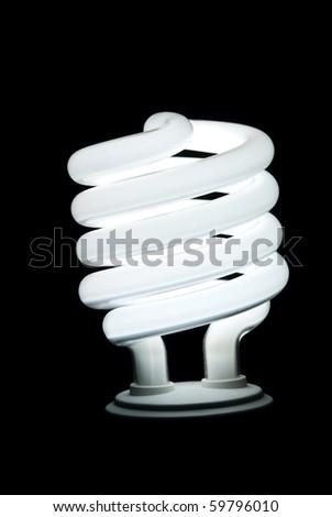 Fluorescent Light Bulb on a black background - stock photo