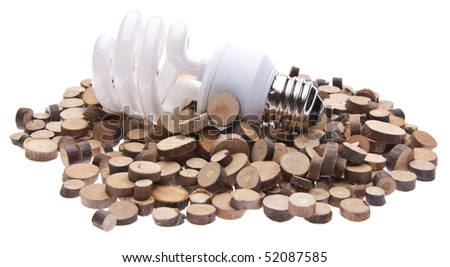 Fluorescent Light Bulb on a Pile of Tree Stumps Isolated on White with a Clipping Path. - stock photo
