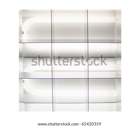 fluorescent lights that are lit up on a ceiling - stock photo