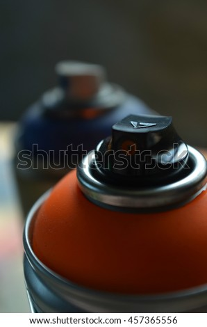Fluorescent Orange Spray Paint Can and Dark Blue Spray Paint Can