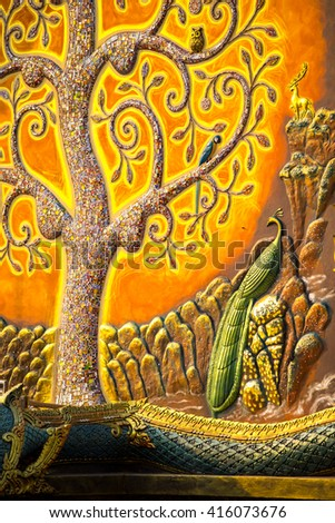 fluorescent tree statue on wall of Wat Pu Praow in Ubonrachathani province in north of Thailand - stock photo