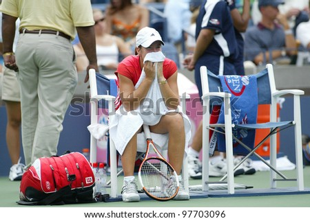 FLUSHING - AUGUST 30: Justine Henin-Hardenne of Belgium rests in between sets against Zuzana Ondraskova of the Czech Republic at Arthur Ashe Stadium on August 30, 2005 in Flushing, NY. - stock photo
