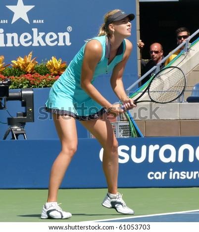 FLUSHING, NEW YORK- SEPT. 4: Maria Sharapova gets ready to return the serve in Arthur Ashe Stadium at the US Open, Sept. 4, 2010, Flushing, New York. - stock photo