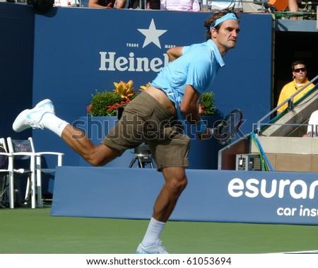 FLUSHING, NEW YORK- SEPT. 4: Roger Federer returns the ball at the US Open at Arthur Ashe Stadium, Sept. 4, 2010, Flushing, New York. - stock photo