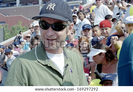 FLUSHING, NY - AUGUST 28: John McEnroe smiles as he attends the US Open Kids Day in Arthur Ashe Stadium August 28, 1999 in Flushing NY. - stock photo