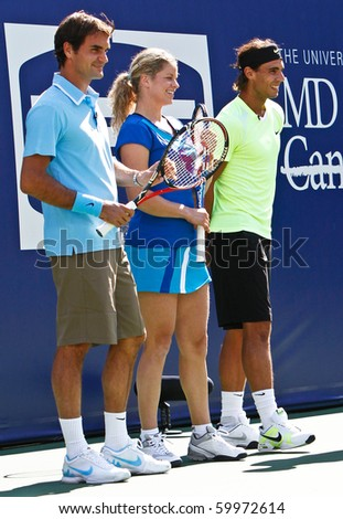 FLUSHING, NY - AUGUST 28: Tennis pros Roger Federer, Kim Clijsters and Rafael Nadal attend Arthur Ashe Kids Day at the Billie Jean King National Tennis Center on August 28, 2010 in Flushing, New York. - stock photo