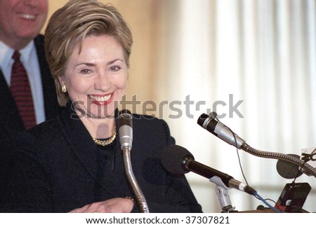 FLUSHING, NY - CIRCA 1998: Former First Lady Hillary Rodham Clinton smiles as she speaks at Electchester circa 1998 in Flushing, NY. Clinton formally announced her senate candidacy in 1999 and won. - stock photo