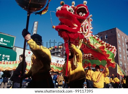 flushing ny january 24 a dragon dance team dances as they participate in - Chinese New Year 2001