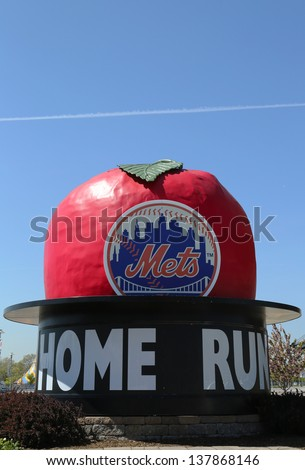 FLUSHING, NY - MAY 2: The Famous Shea Stadium Home Run Apple on Mets Plaza in the front of Citi Field, home of major league baseball team the New York Mets on May 2, 2013 in Flushing, NY. - stock photo